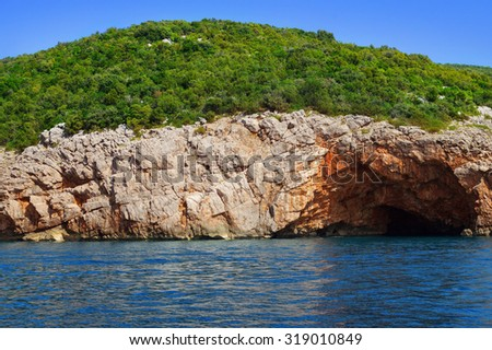 Sea cave in the Adriatic sea, Montenegro - stock photo