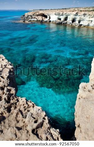 Sea caves. Near Cape Greco. - stock photo