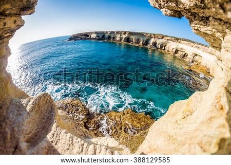 Sea caves near Cape Greko. Mediterranean Sea. Cyprus. - stock photo