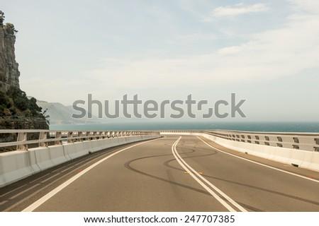 Sea Cliff Bridge burnout tyre marks - stock photo