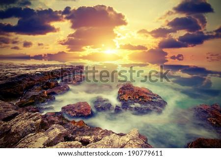 Sea cliffs on the bright sunset. Vintage style - stock photo