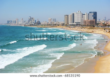 Sea coast and the view of the Tel Aviv from Old Jaffa at the evening - stock photo