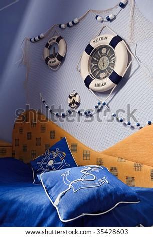 Sea decor in blue bedroom interior - stock photo