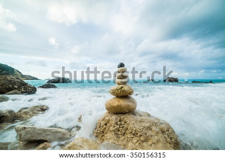 Sea dramatic landscape, harmony environment and zen stones tower silhouette. - stock photo