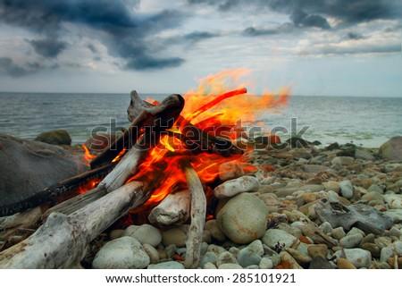 Sea fire. curtains on the coast. rainy weather - stock photo