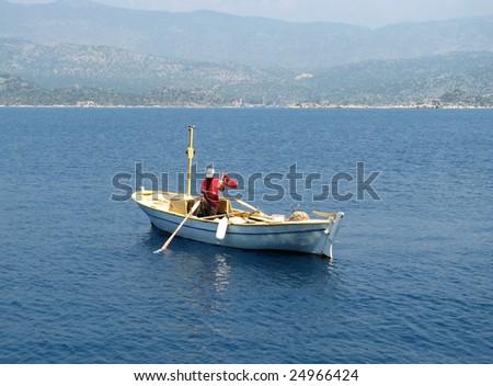 Sea fishing not far from Turkey coast on white boat - stock photo