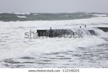 Sea flooding jetty during storm