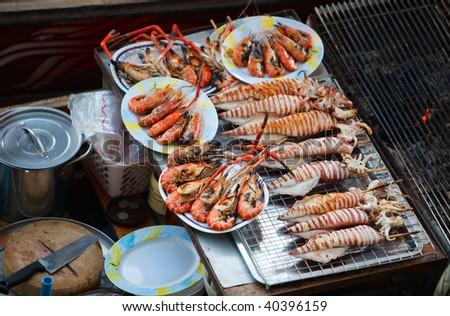 Sea food at Damnoen Saduak Floating Market near Bangkok, Thailand - stock photo