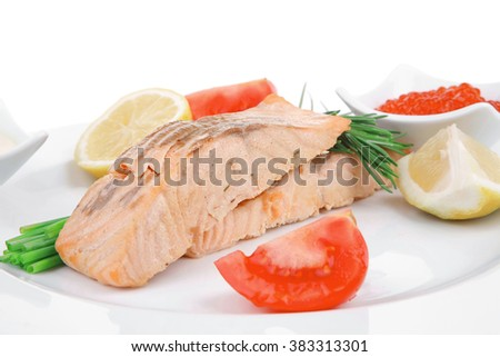 sea food : roasted wild salmon fillet with chives, lime, red caviar, soybean sauce on white dish isolated over white background - stock photo