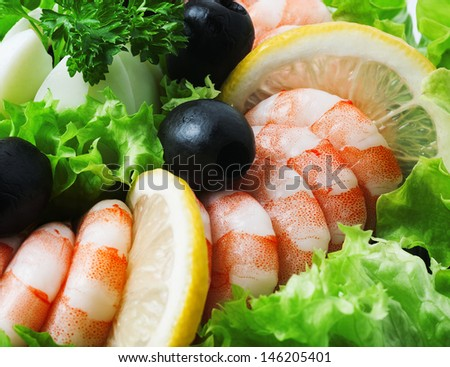 Sea foods - Shrimp and Salmon. Garnished with Fresh Raw Salad Leaf. - stock photo