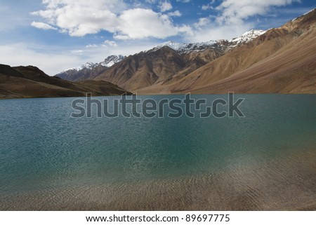 sea-green lake surrounded by mountains - stock photo