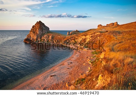 sea gulf with rocks on a sunset in Crimea