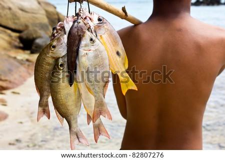 Sea Gypsies and andaman fish - stock photo