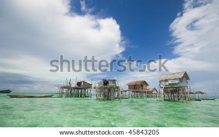 Sea gypsies houses on stilts in Semporna, Sabah, Borneo, Malaysia. - stock photo