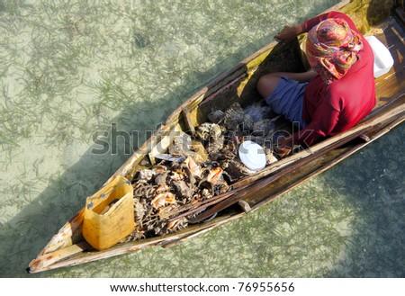 Sea-gypsies woman selling fresh crab. - stock photo