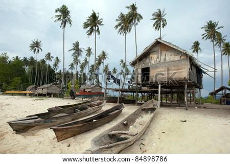Sea gypsy cottage home on a desolated island off the Borneo Island coast. - stock photo