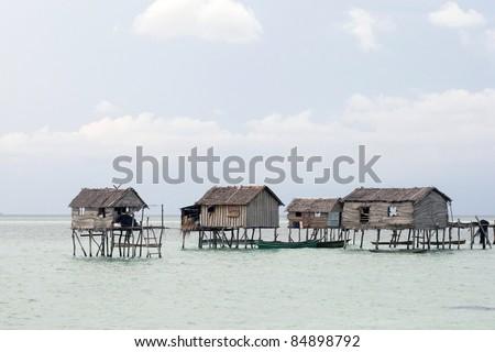 Sea gypsy home on huts built on stilts in the sea off Borneo Island. - stock photo