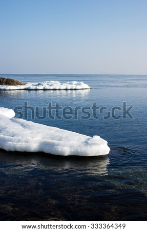 Sea ice, blocks of ice on the sea, the winter ocean, Arctic aquatic nature, the ice floe in the ocean, melting ice, spring in the North sea, the Arctic in the spring, wildlife. - stock photo