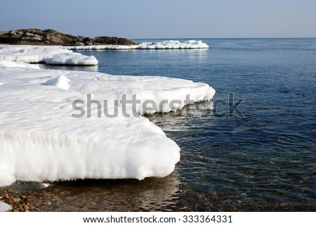 Sea ice, blocks of ice on the sea, winter sea and the ocean, Arctic aquatic nature, the ice floe in the ocean, melting ice, spring in the North sea, the Arctic in the spring. - stock photo