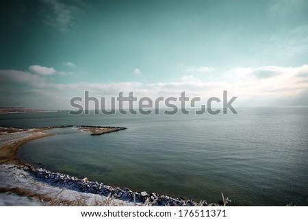 sea in winter in dramatic mood - stock photo