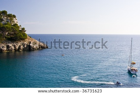 Sea, island, boats and motorcycle of water - stock photo