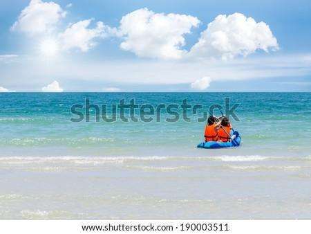 Sea kayak and sun light on ocean sai kaew beach - stock photo