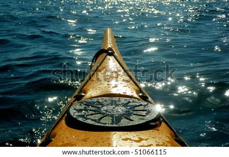 sea kayak in sun - stock photo