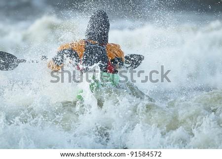 Sea kayak on stormy waves. Storm Quirin on Baltic Sea. - stock photo
