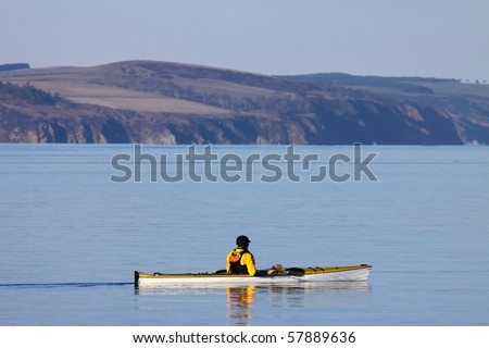 Sea kayaking on a calm sunny day