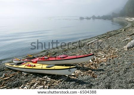 Sea kayaks on remote beach, San Juan Islands, Washington - stock photo