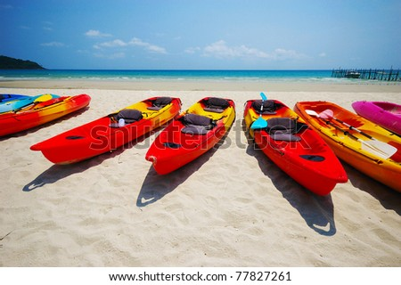 sea kayaks on the beach - stock photo