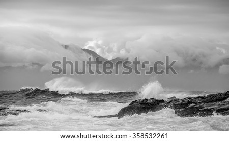Sea landscape. An morning, Clouds sky and mountains. False bay. South Africa.Black and white photo - stock photo