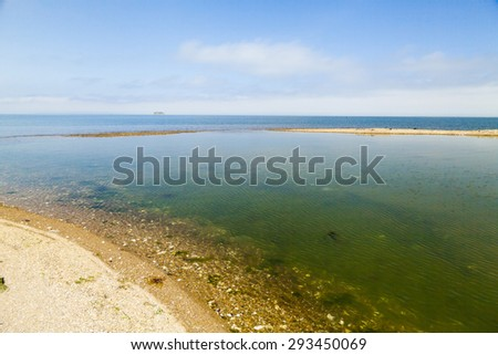 Sea landscape under a bright blue sky in the rays of the bright sun