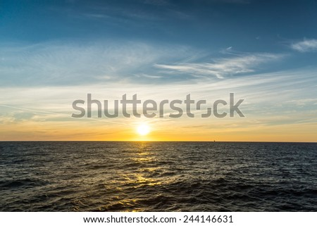 Sea landscape, vivid sunset. Calm sea. - stock photo