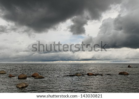 Sea landscape with big clouds. - stock photo