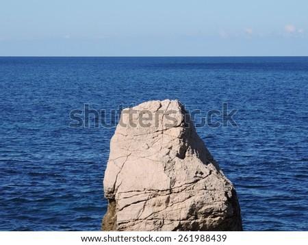 Sea landscape with boulder. - stock photo