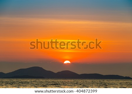 Sea landscape with sunset behind mountain and sea, Pattaya Thailand - stock photo