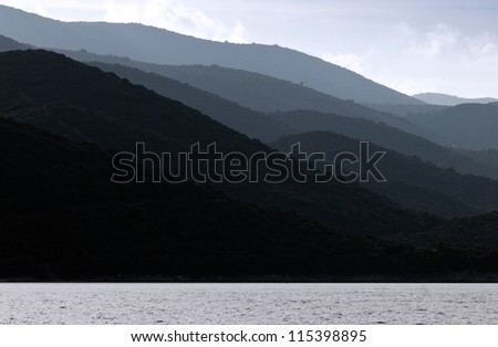Sea, mountains and skies - stock photo
