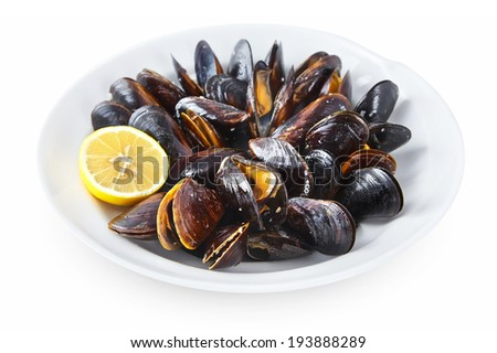 Sea Mussels backed in the oven with olive oil & garlic sauce on the plate isolated on white background - stock photo