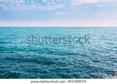 Sea Ocean And Blue Sky Background With Cloudscape in Summer. Vacation on sea