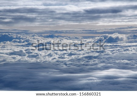 Sea of clouds from airplane window - stock photo