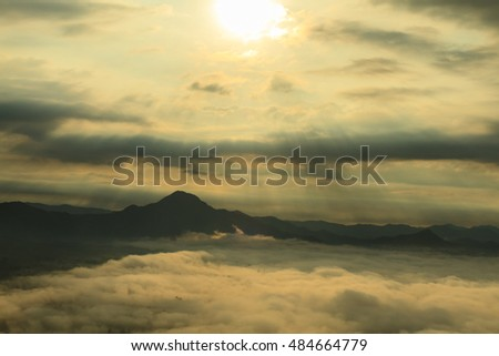 Sea of fog, mountain and sunbeam, Thailand.