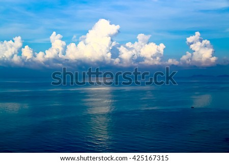 sea or ocean calm water waves, sky cloudscape exotic or paradise background for nature, peace, summer, travel, tropical, tourism, vacation or holiday seascape - stock photo