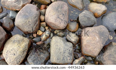 Sea pebble stone around water  abstract natural background