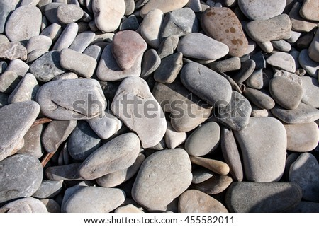 sea pebbles as a background close up - stock photo