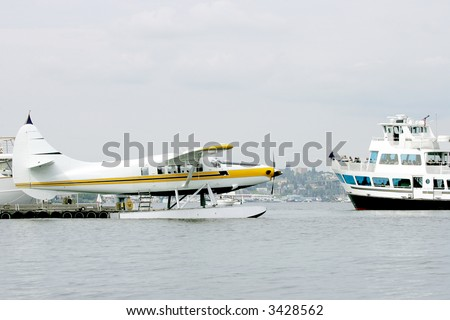 Sea plane and Cruise ship on Union Bay Lake, Seattle, USA