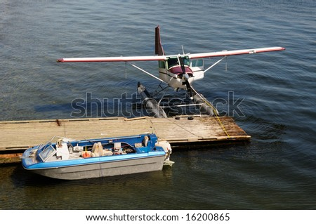 Sea plane docked - stock photo