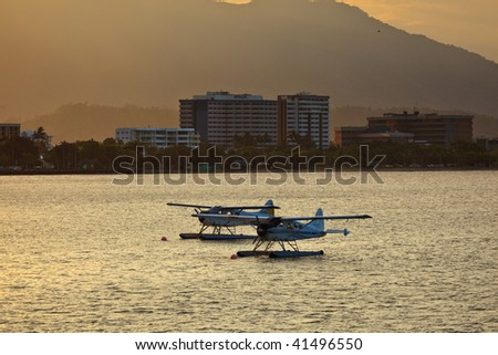 Sea Planes at Sunrise in Cairns Harbor Great Barrier Reef Australia - stock photo