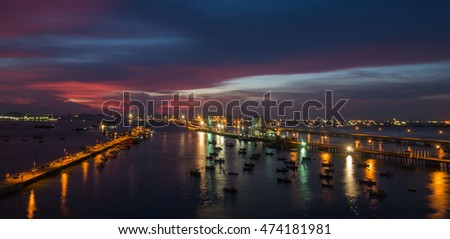 sea port in Hamburg at night with ships and cranes and a  blue violated sky