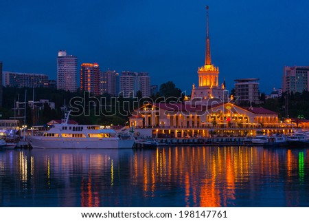 Sea port of Sochi in the warm summer night , view from the sea . - stock photo